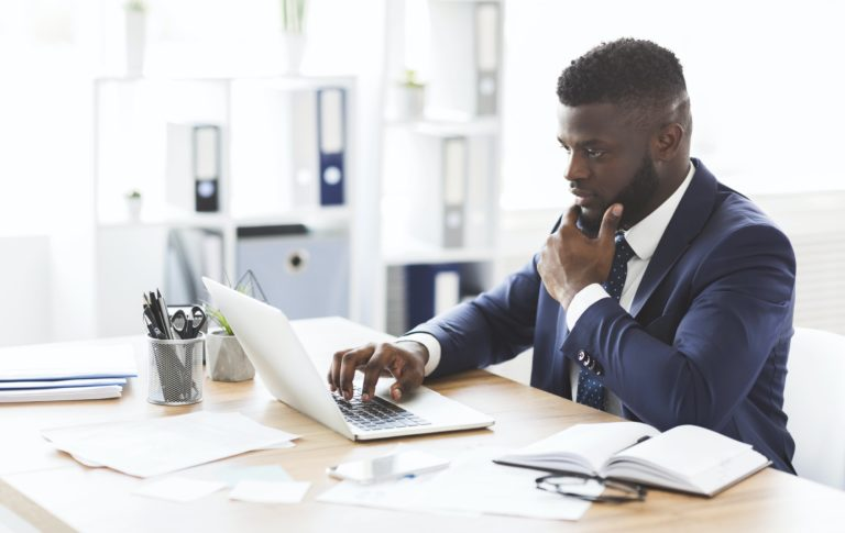 Young african american entrepreneur studying competitors online